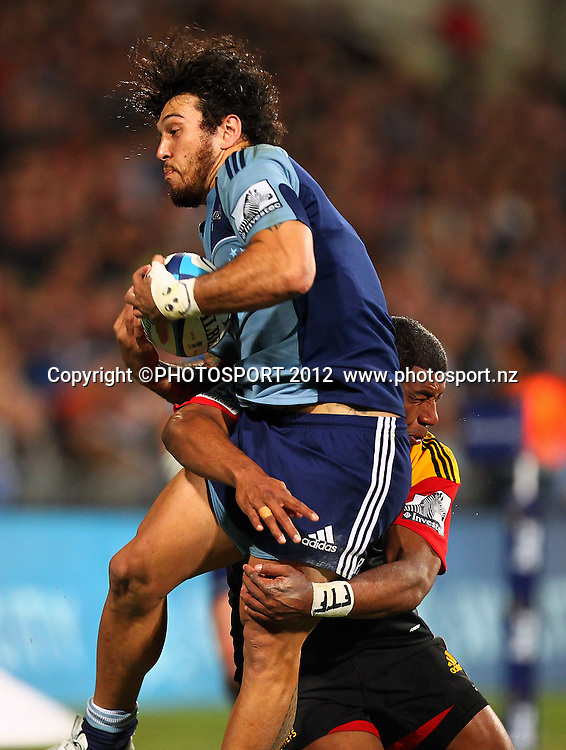 Rene Ranger of the Blues gets hits in the air during the Super Rugby game between The Blues and The Chiefs, North Harbour Stadium, Auckland, New Zealand, Saturday June 2nd 2012. Photo: Simon Watts / photosport.co.nz