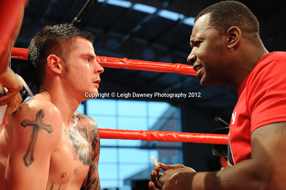Trainer talking tactics to Dave Ryan in his corner during his fight against Adil Anwar in a 10x3 Light Welterweight contest at the Aintree Equestrian Centre, Liverpool on the 19th May 2012. Frank Maloney Promotions © Leigh Dawney Photography 2012.