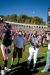 Virginia guard Branden Albert (71) watches the opening coin toss which Virginia won.  The #23 Virginia Cavaliers defeated the #24 Wake Forest Demon Deacons 17-16 at Scott Stadium in Charlottesville, VA on November 3, 2007.