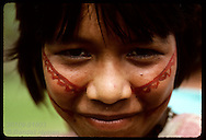 Portrait of Kanamari girl wearing face paint in tribal village of Tres Unidos, Amazonas. Brazil