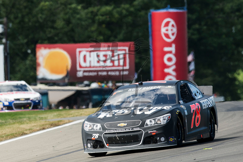 Watkins Glen, NY - AUG 11, 2013: Kurt Busch (78) drives during the Cheez-It 355 at The Glen at Watkins Glen International in Watkins Glen, NY.