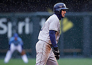Tampa Bay Rays' Matt Joyce watches the pitch from second base as the rain falls in the first inning of a baseball game against the Kansas City Royals at Kauffman Stadium in Kansas City, Thursday, May 2, 2013.  (AP Photo/Colin E. Braley).