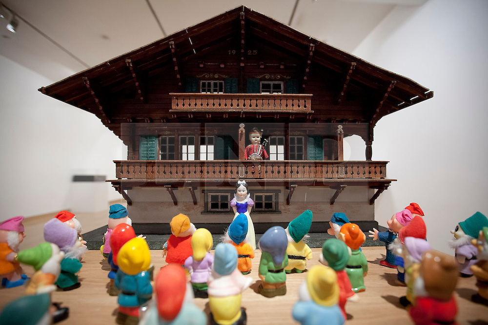 © Licensed to London News Pictures. 21/11/2012. London, UK. 'Swiss Chalet: A Lone Bagpiper Confronts Snow White and her 30 Dwarves' (2012) by Peter Blake is seen at an exhibition in London today (21/11/12). Held at the Waddington Custot Galleries on Cork Street, London, the exhibition, entitled 'Rock, Paper, Scissors', represents the first major retrospective devoted to Blake's work since 2007 and runs from 21November to 15 December 2012 . Photo credit: Matt Cetti-Roberts/LNP