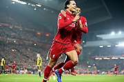 Liverpool defender Virgil van Dijk (4) scores his first goal 4-0 and celebrates with Liverpool midfielder Georginio Wijnaldum (5) during the Premier League match between Liverpool and Watford at Anfield, Liverpool, England on 27 February 2019.