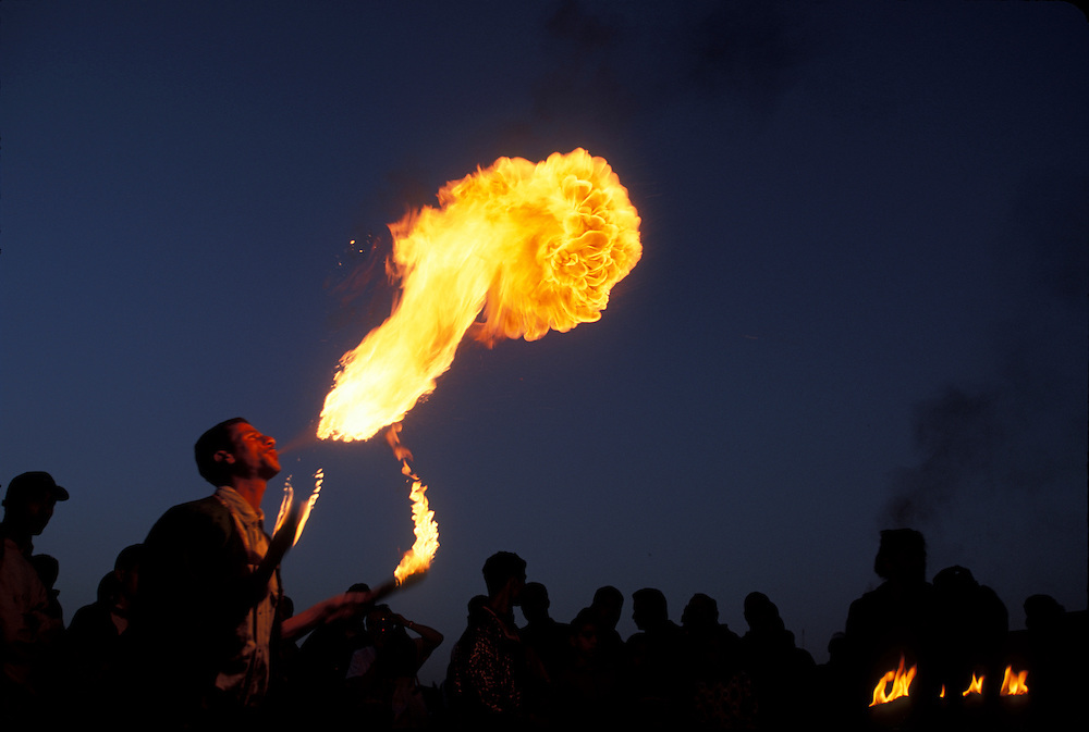 Africa, Morocco, Fire breather performs in Djema El Fna square in Marrakech's old medina