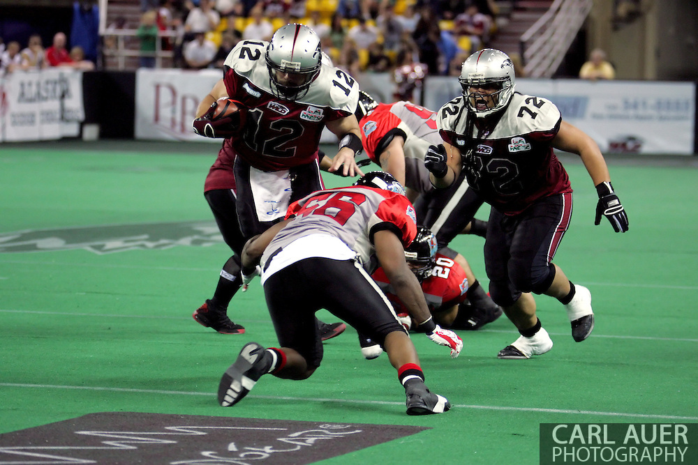 6-28-2007: Anchorage, AK - Wild QB David Short runs a QB keeper against the Barracuda in the Alaska Wild 47 to 53 loss to CenTex at the Sullivan Arena.