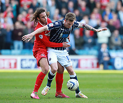 Millwall's Martyn Woolford holds off Charlton Athletic's Diego Poyet - Photo mandatory by-line: Robin White/JMP - Tel: Mobile: 07966 386802 15/03/2014 - SPORT - FOOTBALL - The Den - Millwall - Millwall v Charlton Athletic - Sky Bet Championship