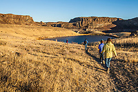 Day hikers approaching Ancient lakes, Eastern Washington, USA.