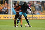 Wolverhampton Wanderers defender Danny Batth holds up Sheffield Wednesday striker Lucas Joao during the Sky Bet Championship match between Wolverhampton Wanderers and Sheffield Wednesday at Molineux, Wolverhampton, England on 7 May 2016. Photo by Alan Franklin.