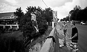 9 January 2009. I found these kids doing summersaults off a bridge in the centre of Lydenburg town, keeping a wary eye for the presence of police.