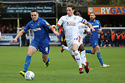 AFC Wimbledon midfielder Anthony Hartigan (8) battles for possession with Luton Town defender Glen Rea (16) during the EFL Sky Bet League 1 match between AFC Wimbledon and Luton Town at the Cherry Red Records Stadium, Kingston, England on 27 October 2018.