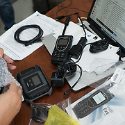 NOVEMBER , 2017&ndash;SAN JUAN, PUERTO RICO&mdash;<br /> NAHJ members Mc Nelly Torres and Rafael Mejia hand out satellite phones to journalists from the Centro de Periodismo Investigativo de Puerto Rico in an effort to help local journalists  better cover their communities. Carla Minet receives a phone and a quick start guide.<br /> (Photo by Angel Valentin)