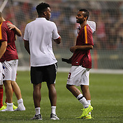 Ashley Cole, (right), AS Roma, talks with Daniel Sturridge, Liverpool, after the Liverpool Vs AS Roma friendly pre season football match at Fenway Park, Boston. USA. 23rd July 2014. Photo Tim Clayton