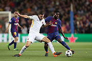 SAMUEL UMTITI of FC Barcelona duels for the ball with KEVIN STROOTMAN of AS Roma during the UEFA Champions League, quarter final, 1st leg football match between FC Barcelona and AS Roma on April 4, 2018 at Camp Nou stadium in Barcelona, Spain - Photo Manuel Blondeau / AOP Press / ProSportsImages / DPPI