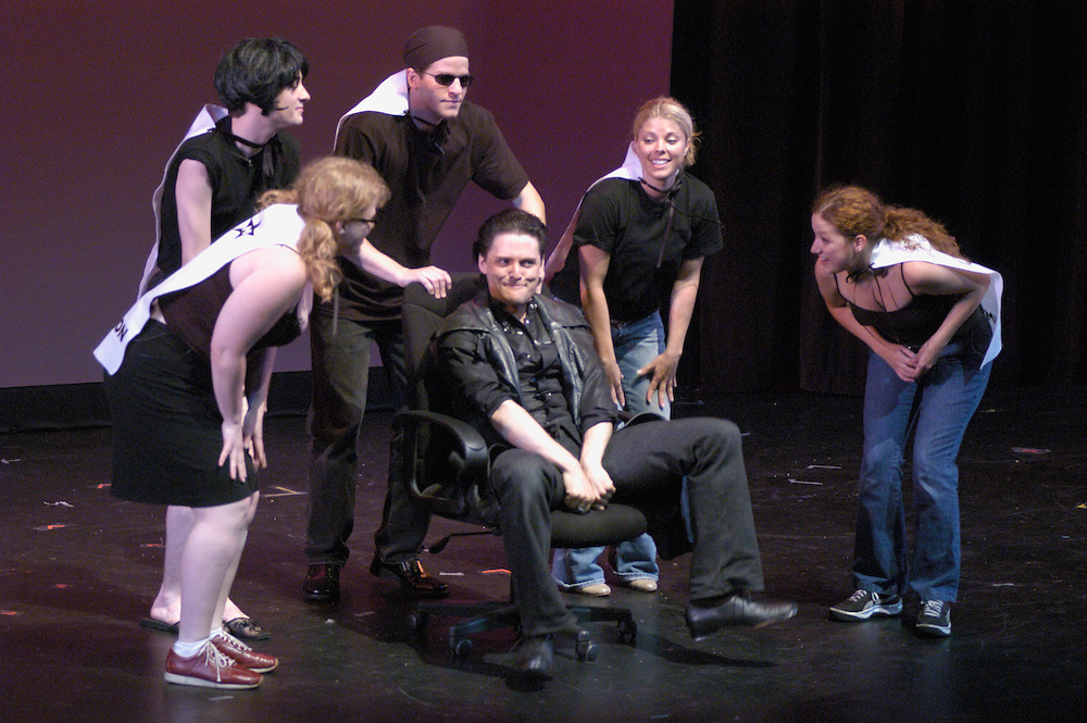 "E.D. (Scoop Slone) and the Patriot Chorus (Sarah Vidal, Josh Fiedler, Brian Reilly, Ginger Kroll, Amy McKee) in a scene from ""John Walker: The Musical"" at the 2004 New York International Fringe Festival"