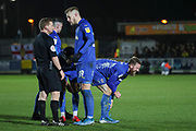 AFC Wimbledon midfielder Scott Wagstaff (7) holding shin after being fouled during the EFL Sky Bet League 1 match between AFC Wimbledon and Burton Albion at the Cherry Red Records Stadium, Kingston, England on 28 January 2020.
