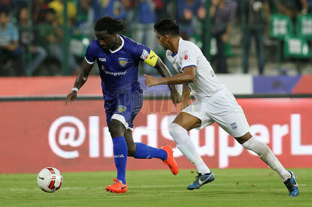 Bernard Mendy of Chennaiyin FC on the attack during match 15 of the Hero Indian Super League between Chennaiyin FC and Mumbai City FC held at the Jawaharlal Nehru Stadium, Chennai, India on the 28th October 2014.<br /> <br /> Photo by:  Vipin Pawar/ ISL/ SPORTZPICS