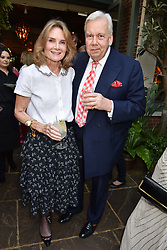 Lady Mary-Gaye Curzon and David Mcdonough at The Ivy Chelsea Garden Summer Party, Kings Road, London, England. 14 May 2018.