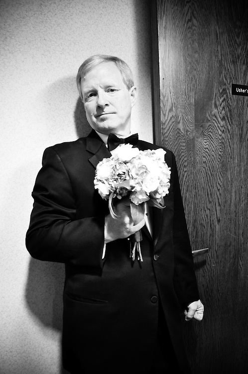 Anne's father dutifully holds the bridal bouquet while his newly-wedded daughter gets her dress bustled, St. Barnabas Catholic Church, Chicago