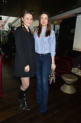 Left to right, AMBER ATHERTON and EMMA MILLER at the mothers2mothers World AIDS Day VIP Lunch with Next Management & THE OUTNET.COM held at Mondrian London, 19 Upper Ground, London on 1st December 2014.