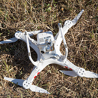 Africa, Botswana, Moremi Game Reserve, Remains of DJI Phantom quadcopter drone after crash into tree while photographing safari animals in Okavango Delta