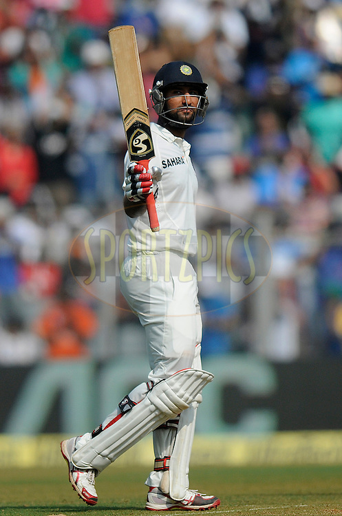 Cheteshwar Pujara of India raises his bat after scoring a half century during day two of the second Star Sports test match between India and The West Indies held at The Wankhede Stadium in Mumbai, India on the 15th November 2013<br /> <br /> This test match is the 200th test match for Sachin Tendulkar and his last for India.  After a career spanning more than 24yrs Sachin is retiring from cricket and this test match is his last appearance on the field of play.<br /> <br /> <br /> Photo by: Pal PIllai - BCCI - SPORTZPICS<br /> <br /> Use of this image is subject to the terms and conditions as outlined by the BCCI. These terms can be found by following this link:<br /> <br /> http://sportzpics.photoshelter.com/gallery/BCCI-Image-Terms/G0000ahUVIIEBQ84/C0000whs75.ajndY