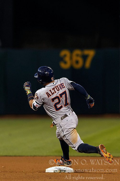 OAKLAND, CA - JULY 19:  Jose Altuve #27 of the Houston Astros rounds second base after hitting a triple against the Oakland Athletics during the fifth inning at the Oakland Coliseum on July 19, 2016 in Oakland, California. The Oakland Athletics defeated the Houston Astros 4-3 in 10 innings.  (Photo by Jason O. Watson/Getty Images) *** Local Caption *** Jose Altuve