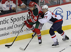 Mar 18; Newark, NJ, USA; New Jersey Devils right wing Dainius Zubrus (8) skates with the puck while being defended by Washington Capitals defenseman Karl Alzner (27) during the first period at the Prudential Center.