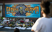 A mural celebrating the life of George Floyd and memorial flowers in Minneapolis, Minnesota on Monday, June 1, 2020.