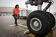 Inspection of an airplane. At Roissy, Nesrine, 34, works as a technical inspector  for the DGCA (Directorate General of Civil Aviation) - she is the only female technical controller at the airport of Roissy-en-France. She can stop a Boeing taking off and make the 300 passengers leave the airplane. Nesrine Chkioua is the only woman controller at Roissy Airport and one of three women doing this job in France.<br /> <br /> <br /> &Agrave; Roissy, Nesrine, 34 ans, exerce le m&eacute;tier de contr&ocirc;leur technique (CTE) pour la DGAC (Direction g&eacute;n&eacute;rale de l&rsquo;aviation civile) - elle est la seule femme contr&ocirc;leur technique &agrave; l&rsquo;a&eacute;roport de Roissy-en-France.  Elle peut immobiliser un Boeing, retarder le d&eacute;collage et m&ecirc;me faire d&eacute;barquer les 300 passagers d&rsquo;un long-courrier. Nesrine Chkioua est la seule contr&ocirc;leur femme &agrave; Roissy a&eacute;roport et est une des trois femmes &agrave; exercer ce m&eacute;tier en France.
