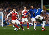 Football - 2018 / 2019 Premier League - Everton vs. Arsenal<br /> <br /> Aaron Ramsey of Arsenal turns past Andre Gomes and Kurt Zouma of Everton, at Goodison Park.<br /> <br /> COLORSPORT/ALAN MARTIN