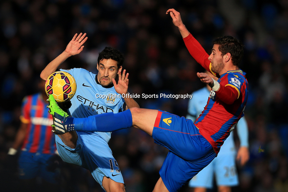 20th December 2014 - Barclays Premier League - Manchester City v Crystal Palace - Jesus Navas of Man City battles with Joel Ward of Palace - Photo: Simon Stacpoole / Offside.