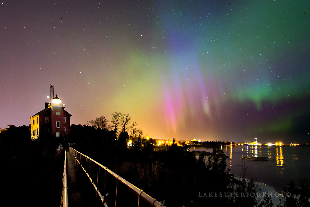 Marquette lighthouse and rare blue aurora