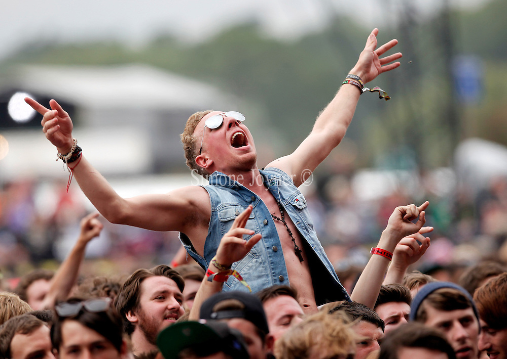 A fan soaks up the atmopshere as Coheed and Cambria perform live on the Main Stage during Day One of Reading Festival 2012 at Richfield Avenue on August 24, 2012 in Reading, England.  (Photo by Simone Joyner)