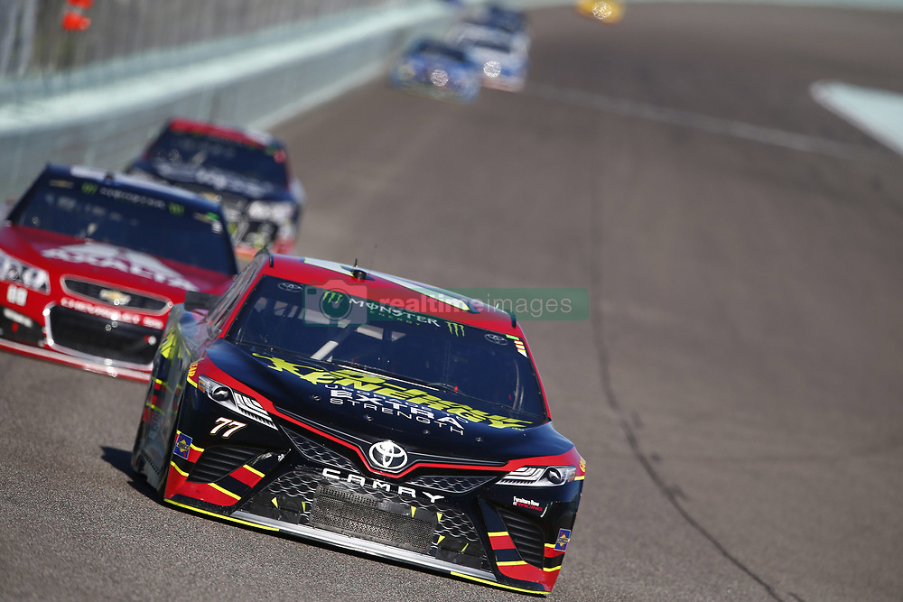 November 19, 2017 - Homestead, Florida, United States of America - November 19, 2017 - Homestead, Florida, USA: Erik Jones (77) battles for position during the Ford EcoBoost 400 at Homestead-Miami Speedway in Homestead, Florida. (Credit Image: © Justin R. Noe Asp Inc/ASP via ZUMA Wire)