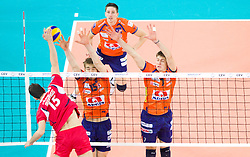 Andreas Fragkos of Olympiacos vs Vid Jakopin, Dejan Vincic and Matevz Kamnik of ACH during volleyball match between ACH Volley (SLO) and Olympiacos (GRE) in 4th Round of 2011 CEV Champions League, on December 14, 2010 in Arena Stozice, Ljubljana, Slovenia.  (Photo By Vid Ponikvar / Sportida.com)