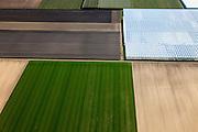 Nederland, Flevoland, Noordoostpolder (NOP), 01-05-2013; detail kassencomplexen in de Noordoostpolder. Lindenweg ten westen van Luttelgeest<br /> Cultivation under glass and farmland near the village of Luttelgeest in the polder (Noordoostpolder).<br /> luchtfoto (toeslag op standard tarieven)<br /> aerial photo (additional fee required)<br /> copyright foto/photo Siebe Swart