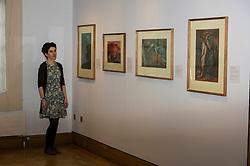 Pictured: Curator of the exhibition Helen Scott takes some time out to consider the works of Wiliam Gibson and John Maxwell<br /> <br /> The City Art Centre's summer exhibition will cover two floors of the gallery with artworks from William Gillies and John Maxwell. The exhibition will open to the public this weekend as part of the Edinburgh Art Festival 2016<br /> <br /> Ger Harley   EEm 28 July 2016