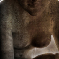 A marble sculpture of a naked young woman with small breasts