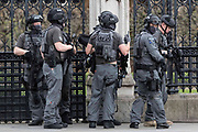 UNITED KINGDOM, London: 22 March 2017 A team of Counter Terrorism Specialist Firearms Officers stand outside Parliament after a suspected terror incident outside the Houses of Parliament in Westminster, London earlier today. It is reported that there has been at least one fatality. Rick Findler / Story Picture Agency