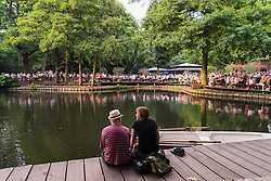 Busy beer garden in summer at Cafe am Neuen See in Tiergarten park in Berlin Germany