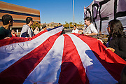 "07 DECEMBER 2010 - PHOENIX, AZ:  Supporters of the DREAM Act fold up an American flag after picketing the offices of US Sen. John McCain in Phoenix Tuesday. Dolores Huerta, who started working in the civil rights movement in the 1960's, threw her support behind students fasting on behalf of the DREAM Act in front of Sen. John McCain's office Tuesday. The student picked McCain's office because he used to support the DREAM Act. They hope that the US Senate will pass the DREAM Act during its ""lame duck"" session. The Senate debated and defeated similar legislation just before the November general election.   PHOTO BY JACK KURTZ"
