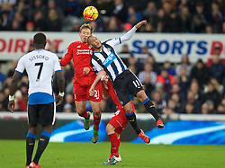NEWCASTLE-UPON-TYNE, ENGLAND - Sunday, December 6, 2015: Liverpool's James Milner in action against Newcastle United's Yoan Gouffran during the Premier League match at St. James' Park. (Pic by David Rawcliffe/Propaganda)