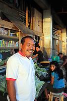 Potrait of happy vendor and family.