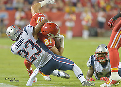 Sep 29, 2014; Kansas City, MO, USA; Kansas City Chiefs tight end Travis Kelce (87) is tackled by New England Patriots strong safety Patrick Chung (23) during the first half at Arrowhead Stadium. Mandatory Credit: Denny Medley-USA TODAY Sports