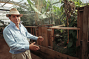 USA_SCI_BIOSPH_86_xs <br /> Biosphere 2 Project founder John Allen inside Biosphere 2 teat greenhouses and livestock areas. Biosphere 2 was a privately funded experiment, designed to investigate the way in which humans interact with a small self-sufficient ecological environment, and to look at possibilities for future planetary colonization. The $30 million Biosphere covers 2.5 acres near Tucson, Arizona, and was entirely self- contained. The eight &lsquo;Biospherian&rsquo;s&rsquo; shared their air- and water-tight world with 3,800 species of plant and animal life. The project had problems with oxygen levels and food supply, and has been criticized over its scientific validity. 1990