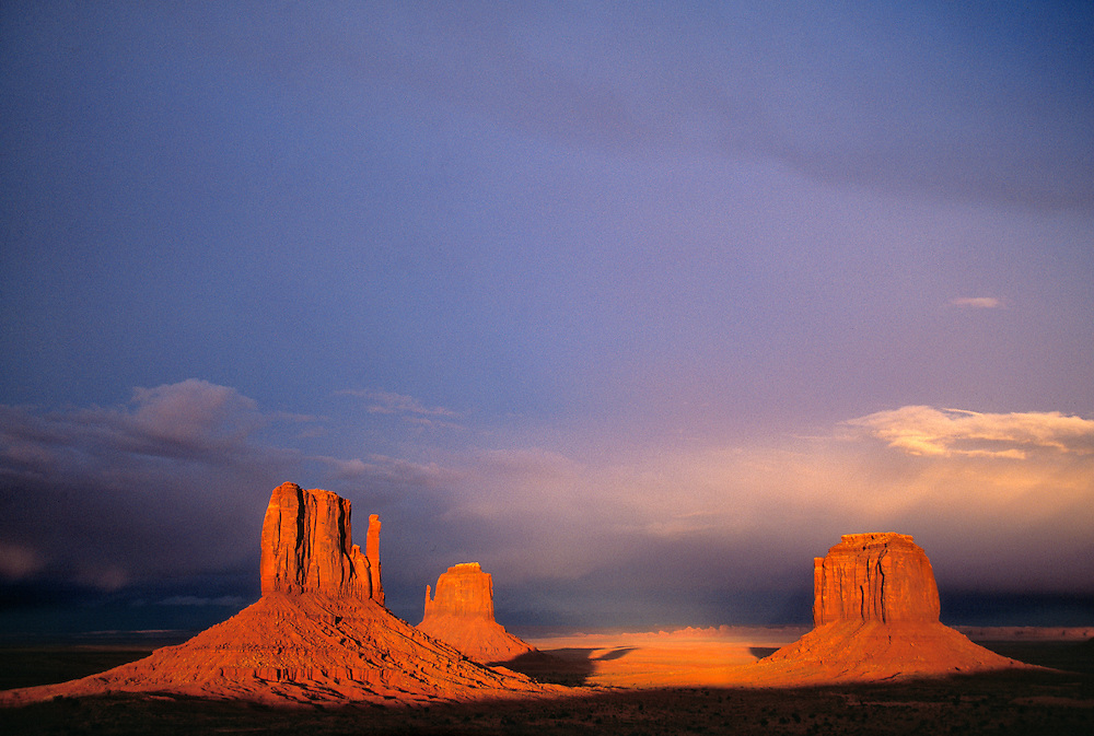 Sunset light colors The Mittens and Merrick Butte in Monument Valley, Utah.