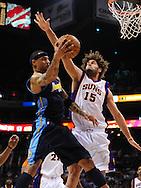 Mar. 10, 2011; Phoenix, AZ, USA; Denver Nuggets forward Kenyon Martin (4) makes a pass against the Phoenix Suns center Robin Lopez (15) at the US Airways Center. Mandatory Credit: Jennifer Stewart-US PRESSWIRE