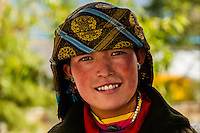 Woman wearing traditional dress from Shigatse, outside the Sera Monastery, outside Lhasa, Tibet (Xizang), China.
