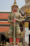 29 FEBRUARY 2008 -- BANGKOK, THAILAND:  A guardian at the entrance to Wat Phra Kaew (Temple of the Emerald Buddha) in the Grand Palace in Bangkok, Thailand. The Grand Palace complex was established in 1782 and houses the royal residence and throne halls, some government offices and the Temple of the Emerald Buddha, the most revered Buddhist temple in Thailand.   Photo by Jack Kurtz